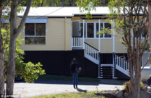 A juror in the trial of Gerard Baden Clay stands outside the former Baden-Clay family residence in Brookfield in Brisbane's west last week