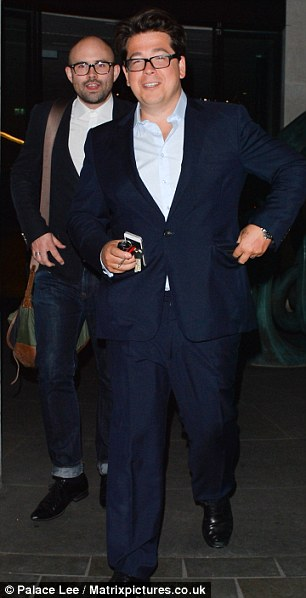 Dapper: The comedian looked smart in a blue suit as he arrived at the ME Hotel on London's Strand