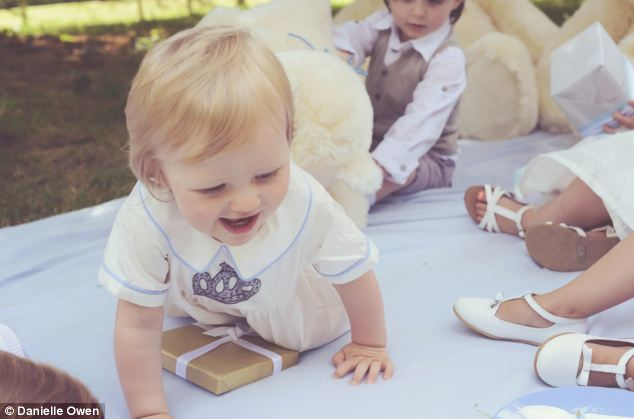 One of George's guests gives a little nod to his host with a crown embellished romper
