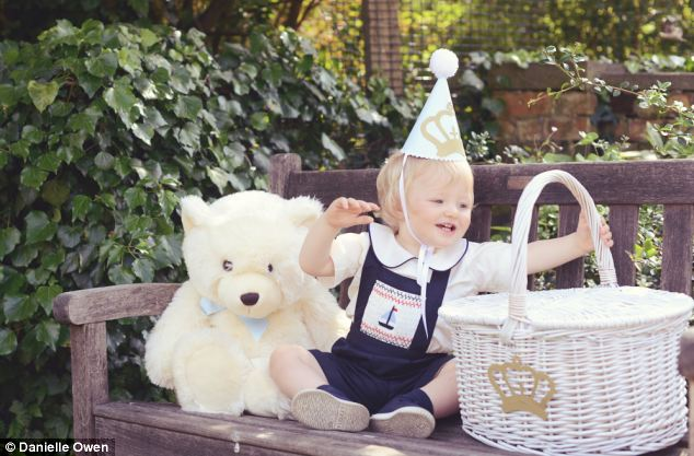 One-year-old Oscar - aka Prince George - getting used to wearing a crown at his imaginary party