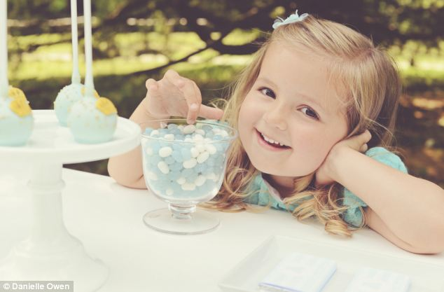 Hands off! A bowl of blue and white bonbons adds style to the table