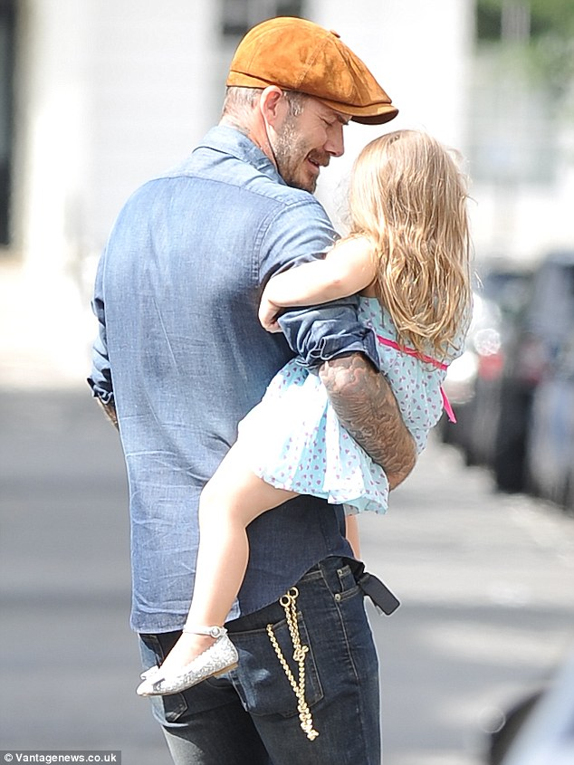 Just the two of us: David Beckham was seen in Notting Hill with Harper on Monday