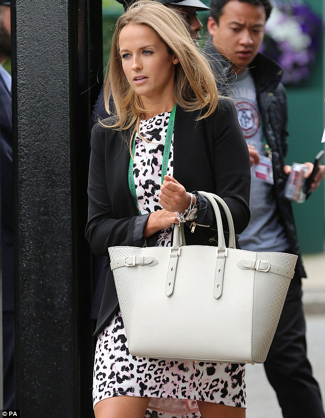 Kim has carried her £1,395 Aspinal 'Marylebone' cream tote bag to every match Andy has played so far