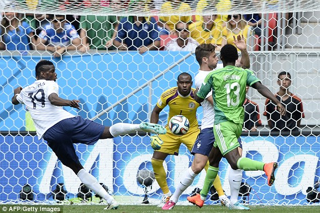 On target: France's Paul Pogba fires a volley towards goal as Olivier Giroud tries to move out of the way