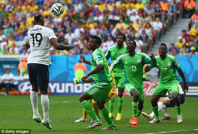 On target: Paul Pogba climbs highest at the back post to give France the lead against Nigeria