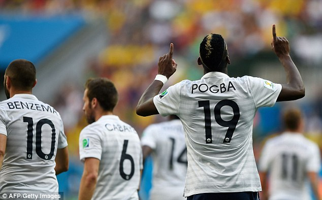 On the scoresheet: Paul Pogba points to the sky after giving France the lead during the last 16 tie