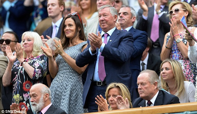 Famous fan: Sir Alex Ferguson stands to applaud Andy Murray during his match with Kevin Anderson
