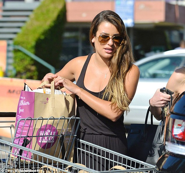 One strong woman: Michele's toned arms were put on full display as she hoisted a bag full of groceries from her cart