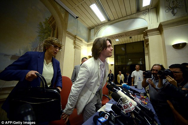 Italian Raffaele Sollecito (C), convicted with former lover Amanda Knox of the grizzly murder of a British student, arrives with his lawyer Giulia Bongiorno (L) for a press conference on July 1st, 2014 in Rome. Knox and Sollecito were first convicted of the murder in 2009, then acquitted in 2011 on appeal. The supreme court last year ordered a re-trial, leading to the guilty verdicts issued on January 31, 2014.  AFP PHOTO / FILIPPO MONTEFORTEFILIPPO MONTEFORTE/AFP/Getty Images
