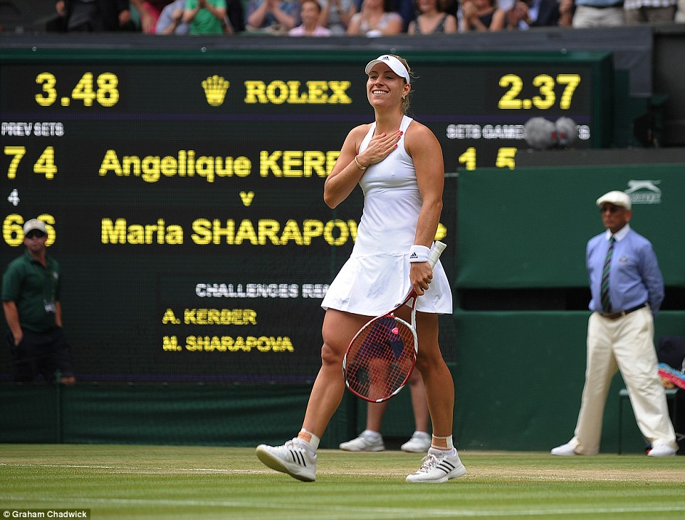 Proud: Angelique Kerber smiles as she walks towards the net following her victory over women's fifth seed Maria Sharapova