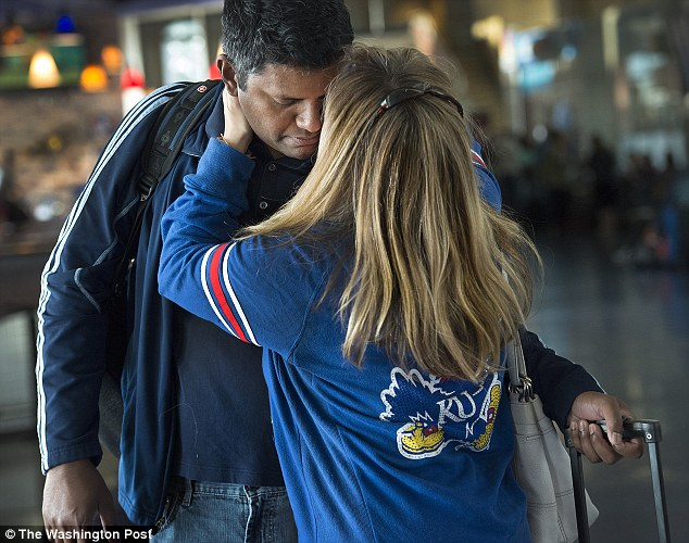 Bangladesh-born Zunu Zunaid says goodbye to his american wife Madina Salaty at the airport before being deported to his own country from Kansas City