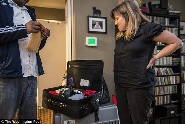 Madina Salaty  watches her husband Bangladesh-born Zunu Zunaid  pack his bags for deportation the next day in Lawrence, KS on May 16, 2014