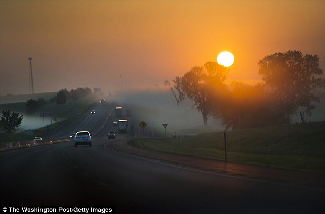 The couple watch the sun rise as they drive to Kansas City airport