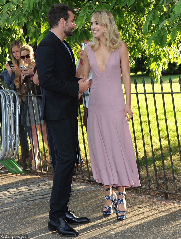 So happy: Bradley Cooper and Suki Waterhouse look smitten as they arrive at the Serpentine for the annual Serpentine Gallery Summer Party in Hyde Park on Tuesday evening