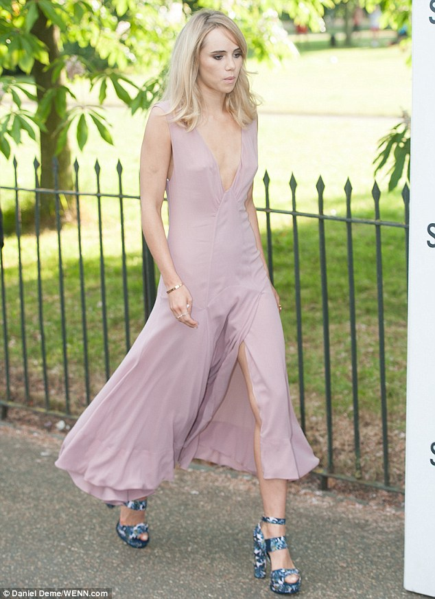 Here she comes: Suki Waterhouse teamed her dress with a pair of distinctive chunky heels