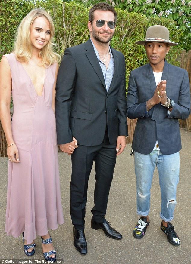 Three's company: Brad and Suki are joined by pint-sized pop star Pharrell Williams