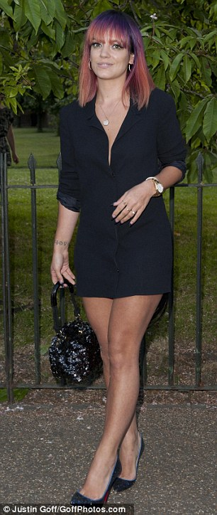 Any chance of a Smile? Singer Lily Allen catches the eye in a smart black shirt dress