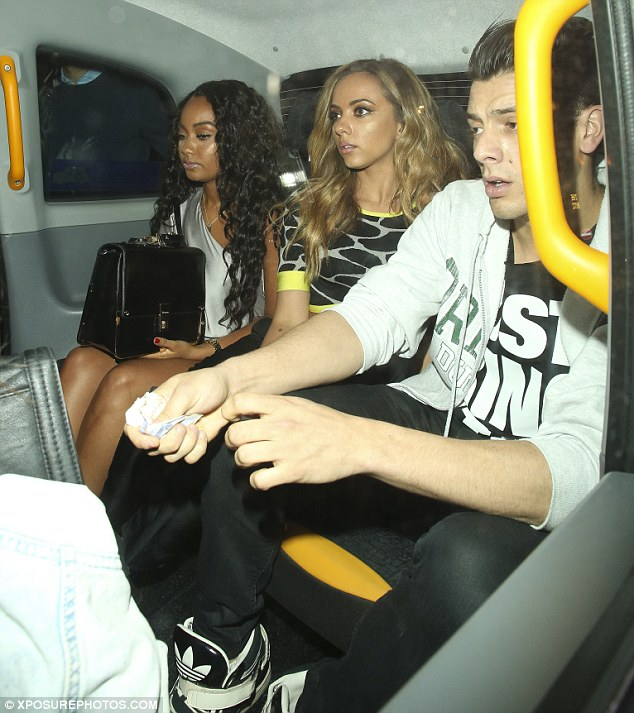Off to Cirque De Soir: Leigh-Anne and Jesy were seen in a taxi with another mystery guy as they departed Mahiki