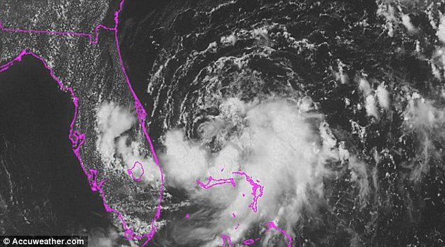 Tropical Storm Arthur was centered about 95 miles southeast of Cape Canaveral, Florida, early Tuesday. It was upgraded from a tropical depression on Tuesday morning