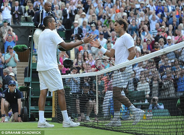 The two players shake hands after the match, which will see Nadal exit the tournament early for the third year running