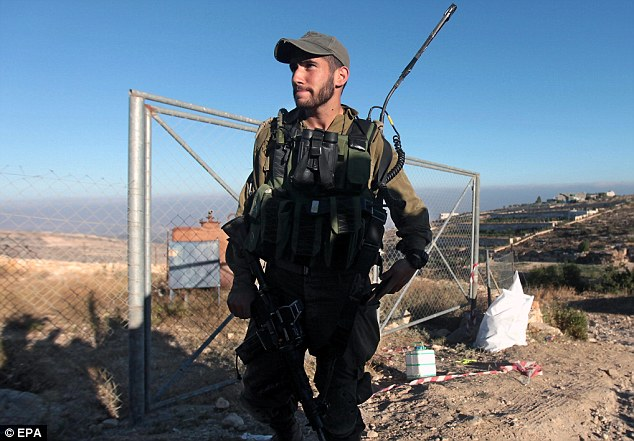 Aggresive crackdown: Israeli soldiers (pictured) have since arrested a number of Palestinians linked to the Islamist group Hamas in the West Bank since the boys' deaths