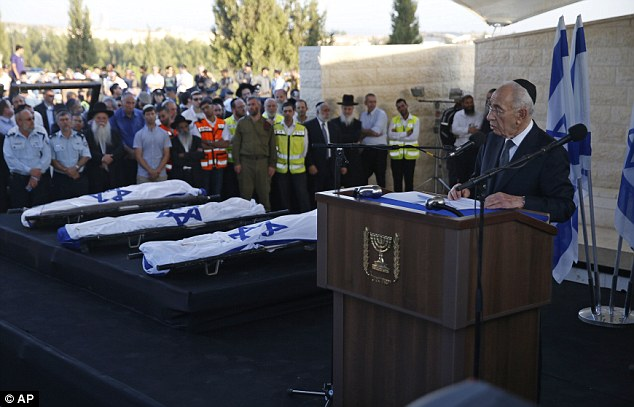 Eulogy: Israeli President Shimon Peres, right, eulogizes the slain teenagers during their joint funeral on Tuesday