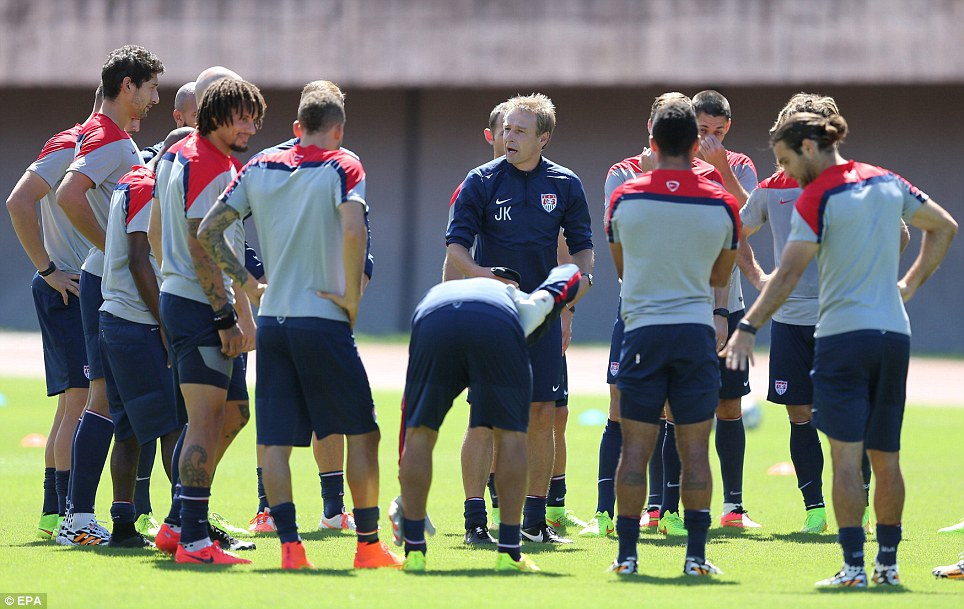 Coach Juergen Klinsmann (center) gives his players a pep talk during training on Monday