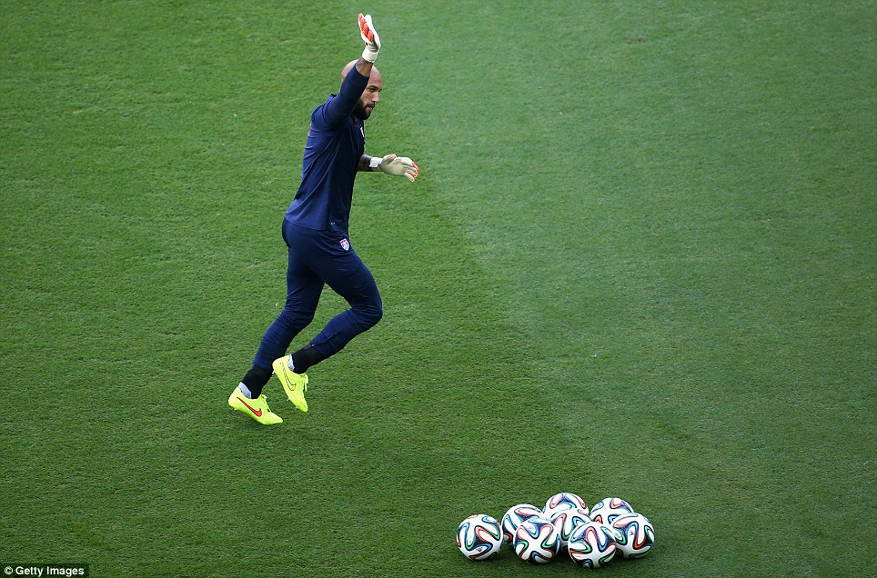 Getting ready: Tim Howard, the star goalkeeper who has kept the Yanks alive through the tournament, warms up before the match Tuesday