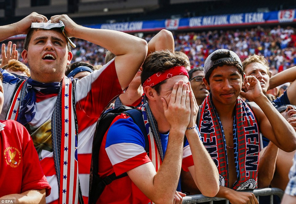The end: Devastated USA fans deflate after watching the Belgians score two un-answered goals in extra time