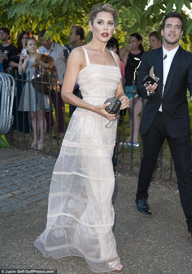 Quite a sight: Danielle looks stunning a she prepares to enter the Serpentine on Tuesday evening
