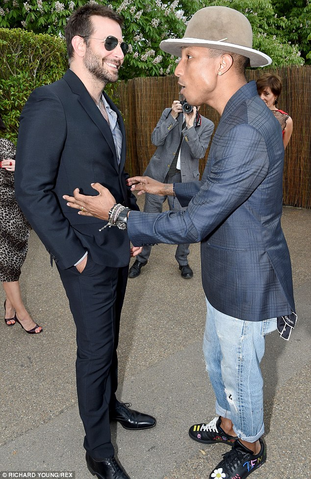 Plenty to smile about: Bradley and Pharrell indulge in a friendly chat