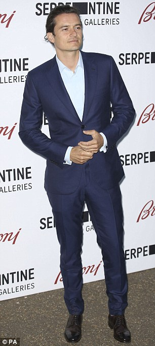 Here come the boys: Orlando Bloom looks dashing in a blue two-piece suit