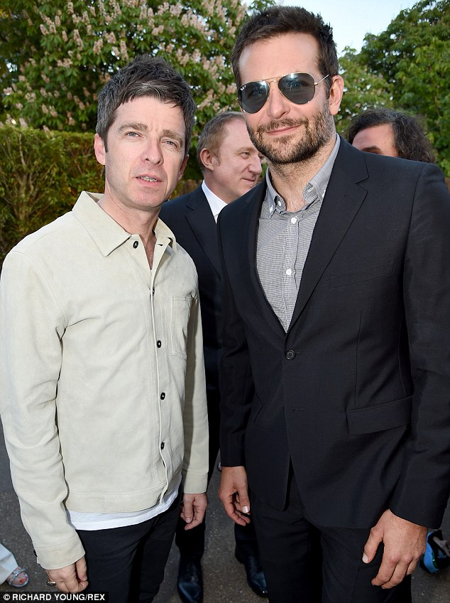 Fancy meeting you here: Bradley is reunited with former Oasis guitarist Noel Gallagher, just days after partying with him at the Glastonbury Festival