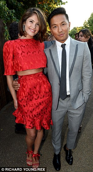 Let's party: Gemma Arterton is side by side with a male friend