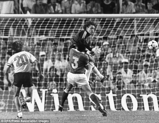 Sickening: West Germany keeper Harald Schumacher collides with France's Patrick Battiston