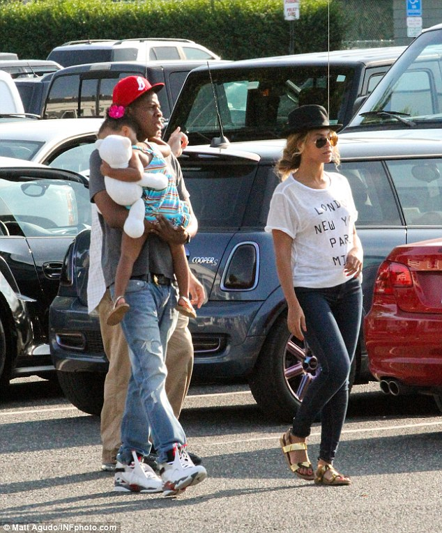 On the rocks? Beyonce - pictured in The Hamptons with husband Jay Z and Blue Ivy - has hinted at marriage troubles as she changed the lyrics in a song about cheating during her performance on the couples On The Run tour in Ohio last month- and again in Seattle on Wednesday night