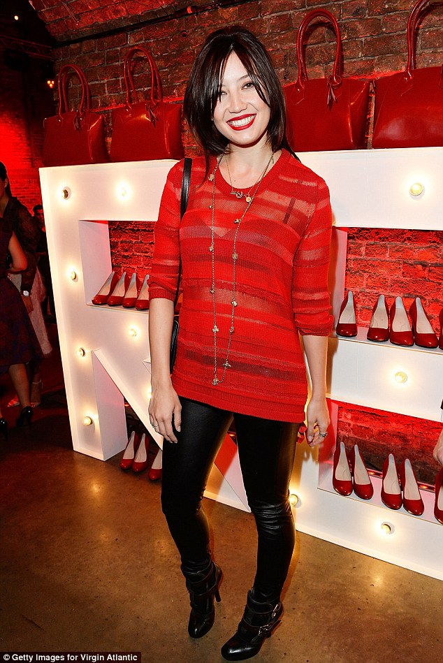 Red alert: Daisy Lowe seemed unfazed about her ex-boyfriend Matt Smith¿s presence as they attended the launch party of Vivienne Westwood¿s uniform collection for Virgin Atlantic