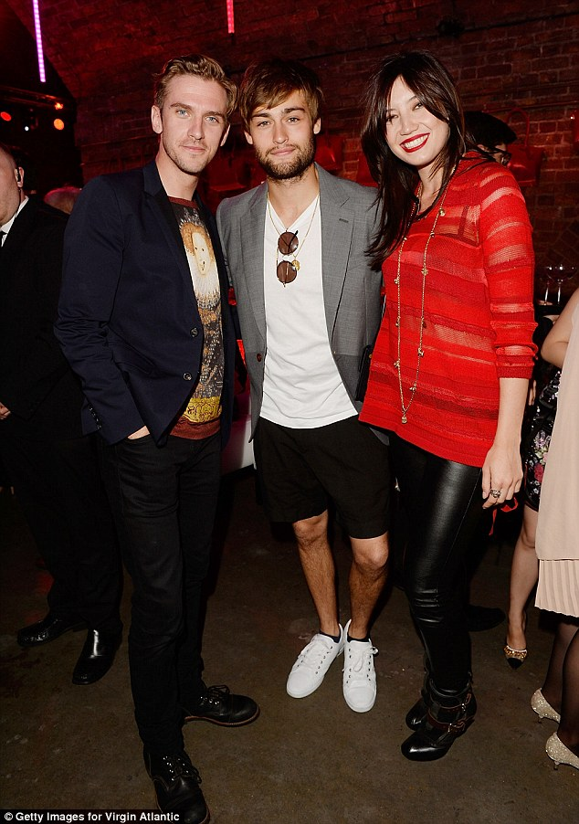 Three isn't a crowd: Also spotted chatting with Daisy were actors Dan Stevens and Douglas Booth who both went for laid-back ensembles
