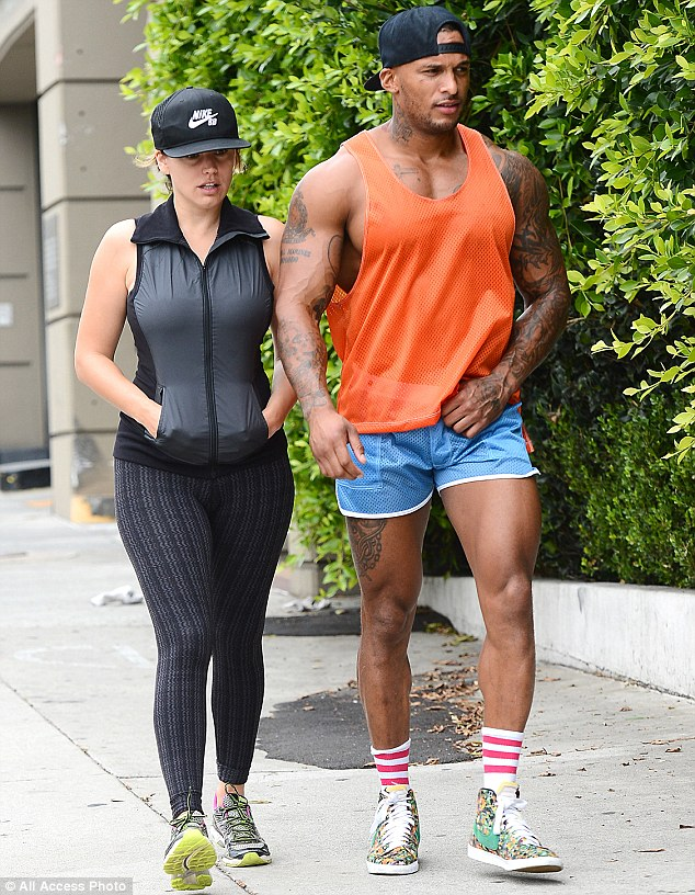They certainly fit together! Kelly Brook leaves a workout with her Gladiator fiance David McIntosh before she was seen dressing up to go shopping on Tuesday in Santa Monica