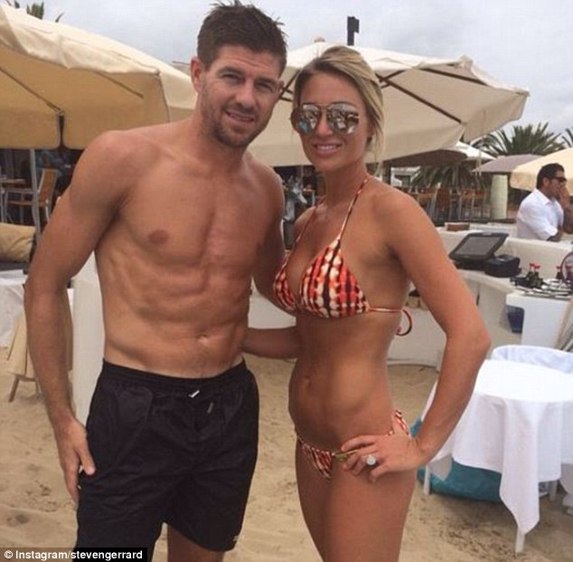Pose: Steven Gerrard and his wife Alex pose for a photo in Ibiza after World Cup exit