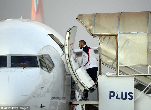 On their way: France striker Karim Benzema boards a plane to fly to Rio de Janeiro on Wednesday