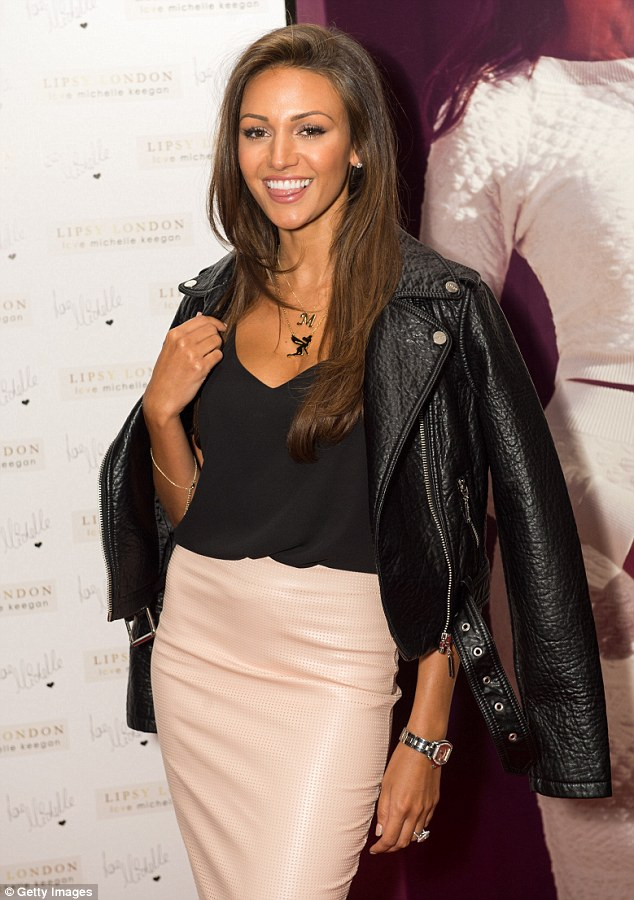 Biker style: First Michelle wore a leather jacket over a black cami with a pale pink pencil skirt at the Rosewood Hotel