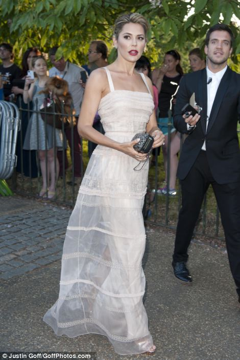 Danielle Lineker wore a vintage-inspired gown, with dark lipstick, her hair swept back in a chignon