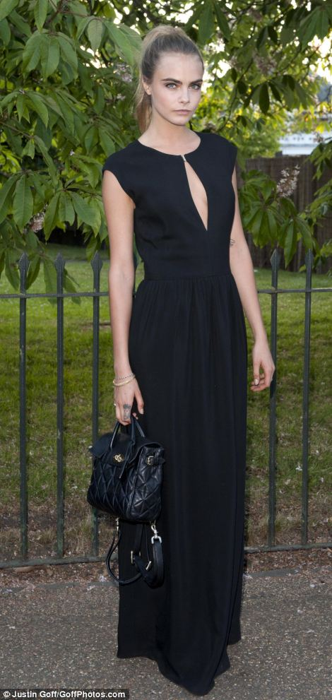 Model behaviour: Cara Delevingne wore a sweeping black gown at the annual event
