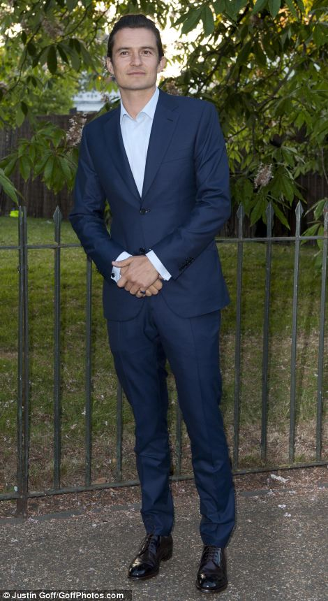 Orlando Bloom looked dapper in a blue suit, with slicked back hair