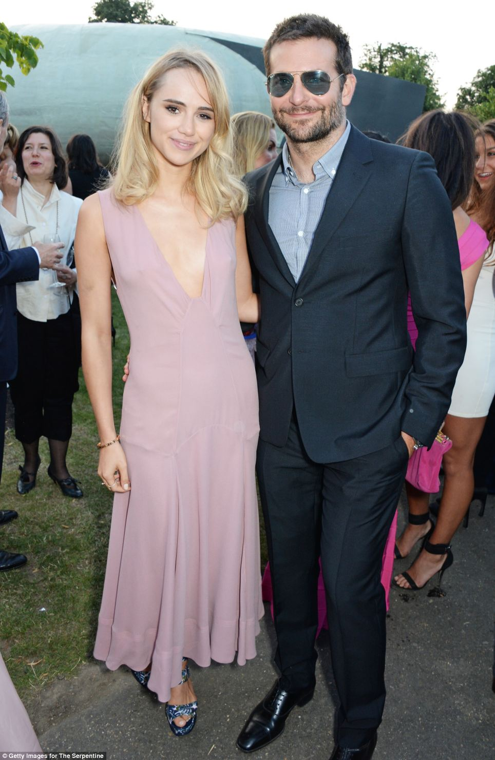 So happy: Bradley Cooper and Suki Waterhouse look smitten as they arrive at the Serpentine for the annual Serpentine Gallery Summer Party in Hyde Park on Tuesday