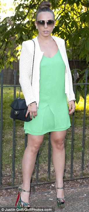 Vibrant: Chloe Green teamed a short green dress with towering snakeskin-print heels