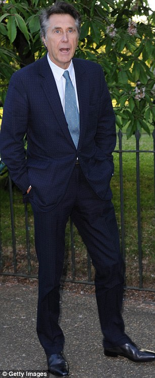 Always a winner: Bryan Ferry opted for a much more classic navy suit