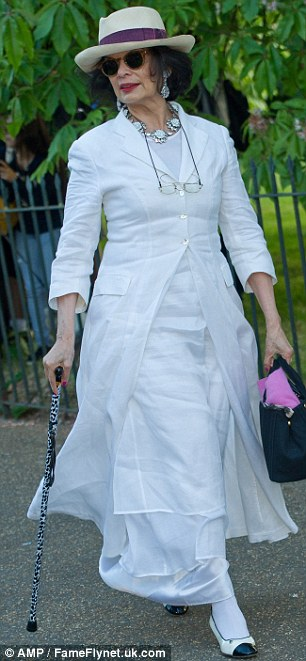 Hats off to them: Bianca Jagger chose an all-white ensemble and chic fedora