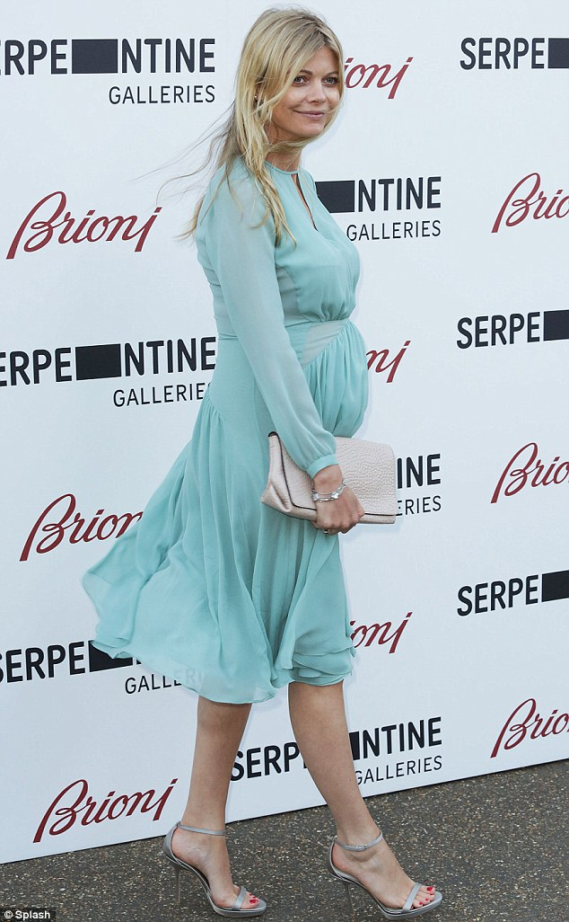 Effortless: Make-up artist Jemma Kidd looked absolutely stunning a floaty blue dress and silver heels